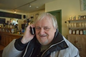 Bob Carswell at Birds & Beans Cafe in Mimico, close to Lake Ontario, where he met with Peter Mearns and Jaan pill in February 2015. In the photo, Bob is listening to the MCHS school song on Jaan's iPhone. Jaan Pill photo