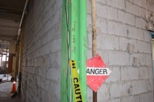 Areas where asbestos is incapsulated are clearly marked at the demolition site. Jaan Pill photo