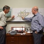 Left to right, Jaan Pill and Peter Milczyn who is pointing to the new version of the Six Points Interchange.