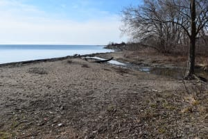 View from the Lake Ontario shoreline at Applewood Creek. The pier isolated beyond Applewood Creek. Jaan Pill photo