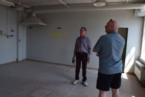 Left to right: Jim Tovey, Lou Klevinas visiting upper-level room at Small Arms Building. Jaan Pill photo