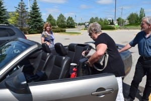 We were all set to take a photo of (left to right) Gina (Davis) Cayer, Lynn (Hennebury) Legge, and Scott Munro in the back seat of Lynn's Mustang, but then we discovered a baby car seat was already occupying the seat! Jaan Pill photo