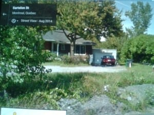 """Bob Carswell has forwarded this photo. He comments: """"Here is the location of Harry's house today on Sarleton Street, in St. Laurent, surrounded by a lot of factories that grew up in the area over the past 50 years or so. No one, would ever realize that this was once the house at 27 Green Lane, just over the tracks. Built by hand...."""" Source: Bob Carswell sent the photo."""