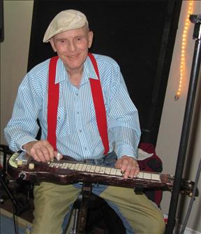 Bobby Hill playing lap steel while recording Echoes From the Wheel Club, 2010. Photo by Craig Morrison. Source: legacy.com Book of Condolences