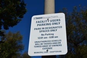 Sign at municipal parking lot at park next to Humber River
