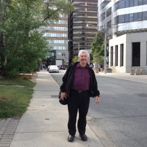Walter Psotka on Alvin Avenue, on his way to Walter Psotka Photography at 39 Alvin Avenue just east of Yonge Street. In the background you can see St' Clair Avenue. Jaan pill photo