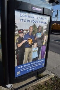 Poster at bus shelter, Lakeshore Road East and Dixie Road. Jaan Pill photo