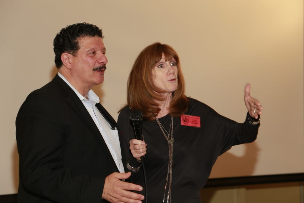 Yes, they did sing the School Song at the MCHS '60s Reunion in Toronto on Oct. 17, 2015. Left to right: Mark Melkonian (MCHS 1970) and Cheryl (Miles) Goldring. They had the rest of us singing along as well, as I recall. MCHS '60s Phys Ed teacher Soryl (Shulman) Rosenberg, at the end of her presentation to the group, encouraged Mark and Cheryl to come up to the front of the room and sing the song. It was a memorable event.  Jaan Pill photo
