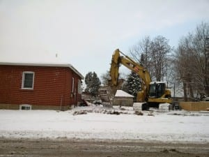 """The photo, from Feb. 17, 2016, shows demolition work proceeding at 20 James Street in a manner - that is, because of the absence of construction fencing - that demonstrates disregard for public safety.  A local resident called 311 on the morning of Feb. 17 and received a response that said: """"Thank you for contacting 311 Toronto. Your email has been forwarded to Toronto Building inspections  for review / response / resolution. If you do not receive a reply within three business days, please contact them at 416.394.8055."""" As it turned out, construction fencing did appear at the site later on  Feb. 17, 2016. Photo source: A resident of Long Branch"""