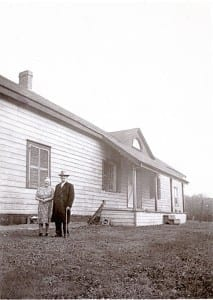 Nell and Robert Christopherson at the back of the Samuel Smith house, where they lived until 1952; the house was torn down in 1955.