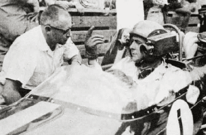 Grand Prix Canada 1967: Robert Brooks CSC, at that time Chetwynd Film's Photography Director (and now President of Robert Brooks Associates) gives instructions to Jack Brabham on the operation of Chetwynd's helmet camera.