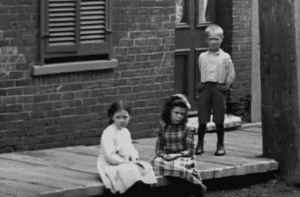 "Screenshot from ""The Rise and Fall of English Montreal (NFB, 1003) showing English-speaking children in a less affluent part of Montreal in the late 1800s."