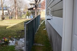 Sump pump in operation on west side of 22 James St. Polling of water from the water discharge is evident at backyard of 26 James St. Jaan Pill photo