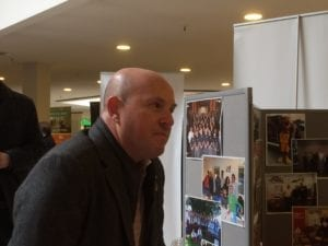 Etobicoke-York MPP Ptere Milczyn, in conversation with a visitor at the Government & Community Services Fair, Feb. 11, 2017. Jaan Pill photo