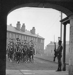 "Royal Canadian Dragoons leaving Stanley Barracks through the arch, c 1925 (courtesy City of Toronto Archives/Fonds 1266, Item 4985). The photo is from a citiesintime.ca webpage entitled: ""Stanley Barracks: Toronto's Last Fort."""