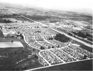 "Caption: Ajax, Ontario, 1951. Most of the housing shown here was built during World War II by Wartime Housing Limited. Source: Ontario Archives. The photo is featured in an Urban History Review 1986 article by Jill Wade entitled: ""Wartime Housing Limited, 1941 - 1947: Canadian Housing Policy at the Crossroads."""