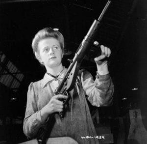 "Factory worker posed with finished Sten sub-machinegun, Small Arms Plant, Long Branch, Ontario, Canada, 26 May 1942' Photographer"" Nicholas Morant Source: ww2dbaseLibrary and Archives Canada, Identification Code WRM-1929"