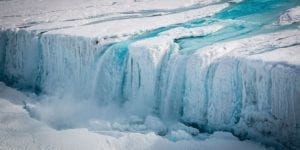 A 130-metre-wide waterfall drains meltwater from the Nansen Ice Shelf into the ocean. Image: Stuart Rankin via Flickr. The image is from the April 22, 2017 Climate News Network article mentioned at the page you are now reading.