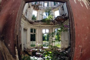 Inside view of an abandoned 19th-century manor in Goussainville-Vieux Pays, 20 kilometers north of Paris, on September 9, 2013. In 1972, the farming village of 144 homes found itself under the direct flight path of Roissy's Charles de Gaulle Airport when it opened. Residents started to abandon their homes, unable to endure the constant noise of the passenger planes flying overhead. Nowadays, only a few families remain living in what has become almost a ghost village.