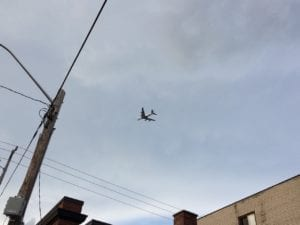 On a walk around July 31, 2017 by the corner of Fortieth St. and Lake Shore Blvd. West, I noticed a phenomenon quite distinct from the issue of parking at the corner. I noticed a jet flying to Pearson Airport. The jets were fling quite low. I became interested in getting as much of a jet into the picture frame of my iPhone, as i could, as the jets proceeded to fly overhead.