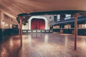 The photo is from the Toronto Star link at the page you are now reading. Cation reads: The restored Great Hall includes design details and materials rarely seen these days, such as Crown mouldings, oak floors and hand-painted walls. (DOMINIQUE VAN OLM)