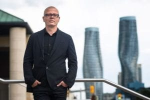 The image is from the metro news.ca article highlighted at the post you are now reading. The captions reads: Stuart Keeler, The Story of M's project manager and chief curator. Credit: EDUARDO LIMA / METRO
