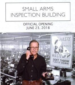 The photo is from the Snaptique Photo Booth, which was set up at the east windows of the room where the Small Arms Inspection Building Official Opening took place on June 23, 2018. At the booth, people (such as myself, in the photo) could choose from a variety of historical artifacts. In my case, I chose a rotary-dial telephone, of a kind that I remember from my childhood in Montreal in the 1950s.